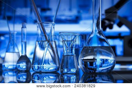 Science Concept Background. Chemical Experiment. Microscope, Glass Beakers And Test Tubes In Laborat