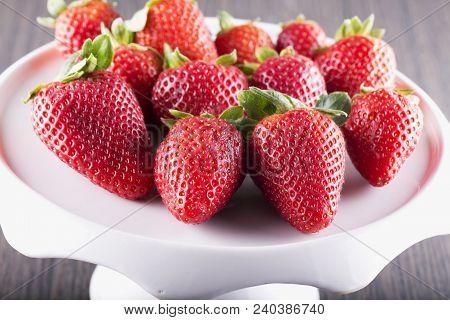 Strawberries Over White Riser