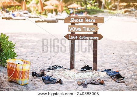 The Wooden Sign On The Beach At The Wedding Ceremony For Guest To Take Off The Shoes Before Entering