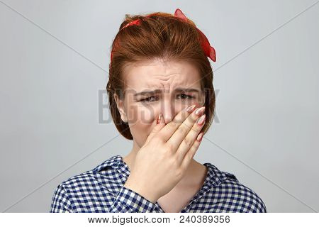 Isolated Shot Of Disgusted Attractive Young Caucasian Woman In Stylish Outfit Grimacing, Pinching No