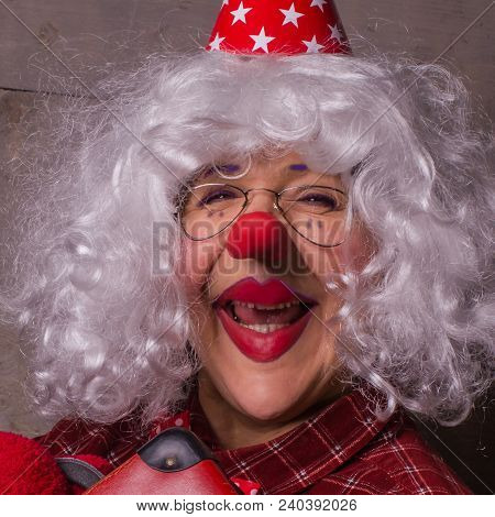 Funny Clown With Blonde Wig, Glasses And Red Nose.