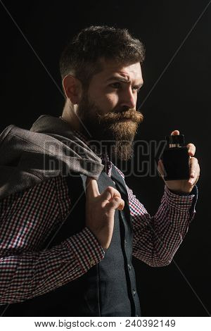 Man Perfume, Fragrance. Handsome Bearded Man In Stylish Retro Clothes With Bottle Of Perfume. Male F