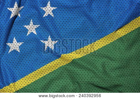 Solomon Islands flag printed on a polyester nylon sportswear mesh fabric with some folds poster
