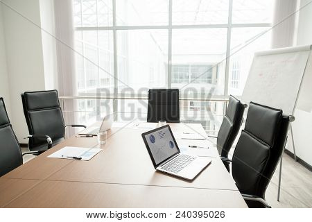 Modern Office Boardroom Interior With Laptops Documents On Conference Table And Big Window, Empty Co