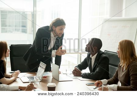 Angry Mean Boss Scolding Incompetent Employee For Bad Work Results At Diverse Group Meeting, Company