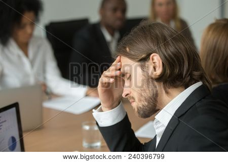 Frustrated Tired Businessman Having Headache At Team Meeting, Upset Company Ceo Feeling Unwell Suffe