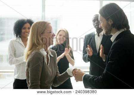 Boss Handshaking Rewarding Motivating Successful Female Employee Congratulating With Promotion, Appr