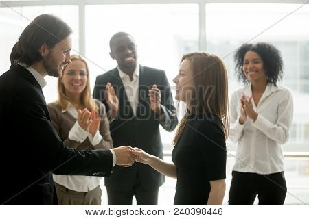 Smiling Ceo Promoting Rewarding Handshaking Motivating Female Worker Congratulating With Promotion O
