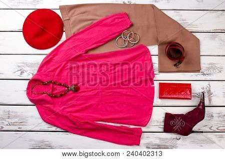 Set Of Female Elegant Outfit, Top View. Women Fashion Apparel And Accessories On White Wooden Backgr