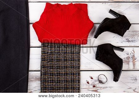 Flat Lay Of Female Classic Apparel. Women Red Sweater, Skirt And Black Classic Boots. Set Of Women C