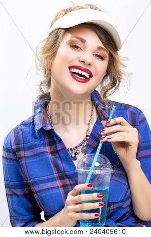 Happy Lifestyle Concepts. Portrait Of Upbeat Smiling Caucasian Blond Woman In Checked Shirt Drinking