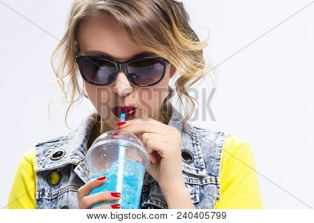 Happy Youth Lifestyle Concepts. Closeup Of Upbeat Caucasian Blond Girl Drinking Blue Cocktail Throug