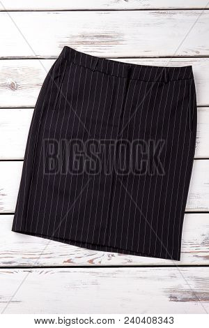 Female Black Casual Skirt. Women Striped Classic Skirt On White Wooden Shelf. Feminine Formal Appare