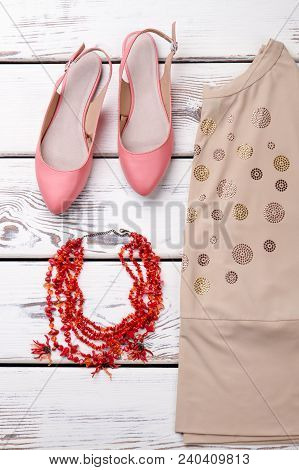 Set Of Feminine Fashion Clothes And Accessories. Women Blouse, Sandals And Necklace On Wooden Backgr