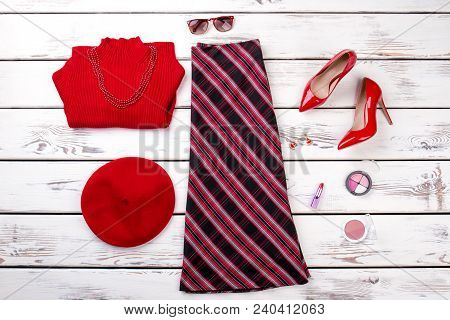 Flat Lay Female Stylish Clothes And Accessories. Women Elegant Skirt, Red Heels, Beret And Sweater.