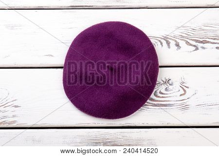 Purple Color French Beret For Women. Female New Stylish Autumn Headgear, White Wooden Background. Be