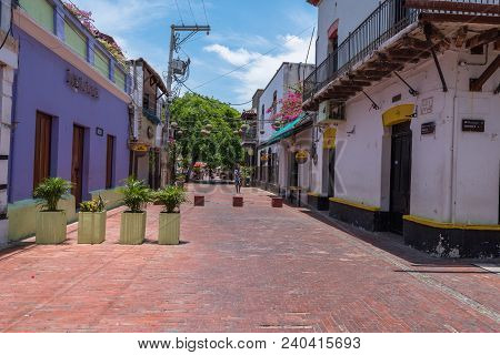 Santa Marta, Columbia -- April 22, 2018. Flower Pots Block Off A Side Street From Regular Traffic On