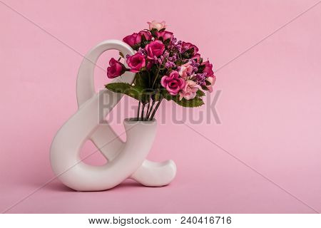Decorative White And Symbol On Pink Background