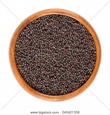 Rapeseed Seeds In Wooden Bowl. Black Seeds For Sprouting. Brassica Napus, Known As Rape Or Oilseed R