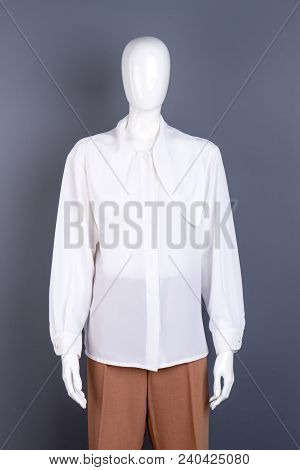 Female White Elegant Shirt On Mannequin. Chiffon Long Sleeve Blouse For Women. Ladies Classy Outfit.