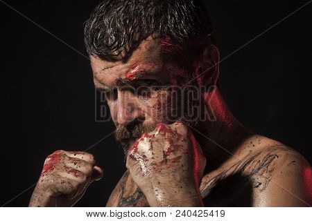 Sport, Boxing, Fighting. Man In Fight Position With Blood Paint On Face, Fists. Power, Might, Magic.