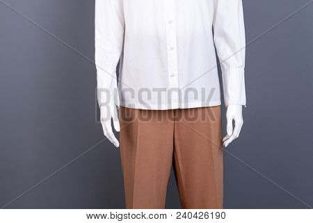 Mannequin Dressed In Female Shirt And Trousers. Women Elegant Clothes On Sale. Ladies Classic Appare