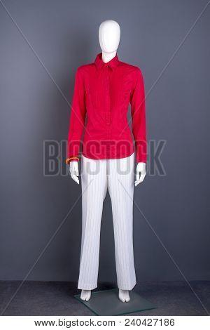 Full Length Mannequin In Red Women Shirt. Female Red Cotton Blouse And White Trousers. Feminine Eleg