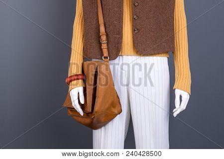Sweater, Waistcoat, Handbag On Female Mannequin. Brown Leather Handbag For Women. Feminine Stylish C