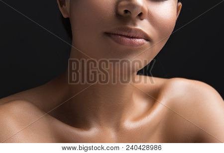 Appearance Treatment Concept. Close Up Of Female Chubby Lips With Natural Tone And Nude Shoulders