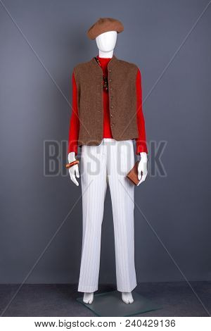 Mannequin In Brown Beret And Waistcoat. Red Sweater And Brown Sleeveless Vest. Feminine Trendy Garme