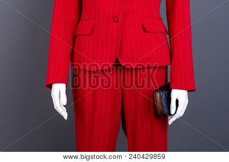 Close Up Mannequin With Female Suit And Wallet. Women Red Blazer And Trousers, Cropped Image. Femini
