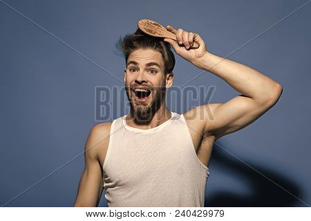 Happy Man Brush Hair With Hairbrush On Blue Background. Haircare, Hairstyle Concept. Macho With Bear