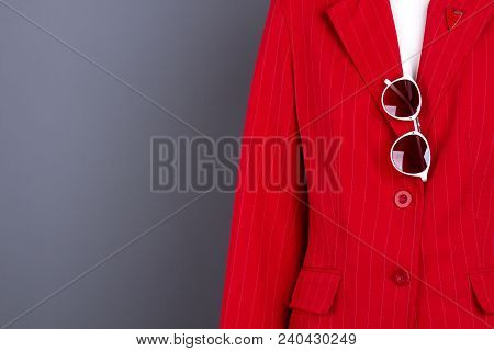 Women Elegant Blazer, Sunglasses And Copy Space. Female Mannequin In Red Fashion Jacket, Grey Backgr