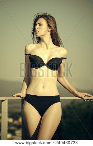 Spa And Wellness. Summer Vacation Concept. Fashion Model With Slim Body And Belly On Natural Landsca