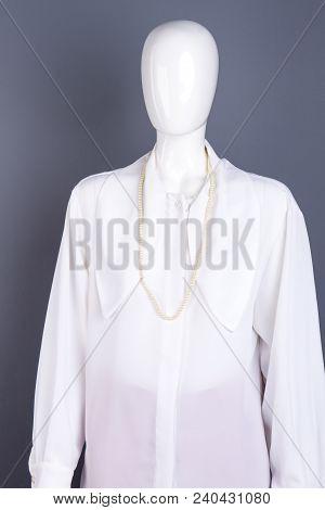 Women White Chiffon Blouse On Mannequin. Female Mannequin Dressed In Elegant Long Sleeve Shirt, Grey