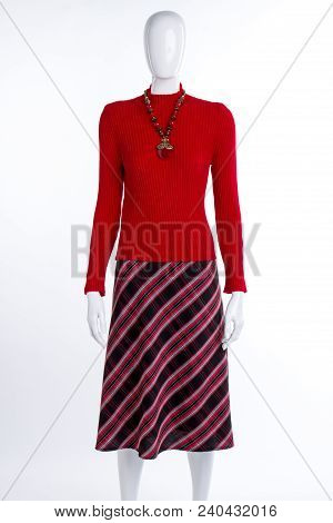 Red Sweater, Skirt And Necklace. Female Mannequin Dressed In Red Pullover, Striped Skirt And Jewelry