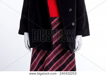 Close Up Black Coat And Patterned Skirt. Mannequin In Women Overcoat, Skirt And Sweater Close Up, Wh
