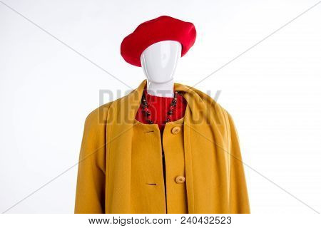 Red Beret And Yellow Coat For Women. Female Mannequin Dressed In Colorful Hat And Overcoat Close Up,