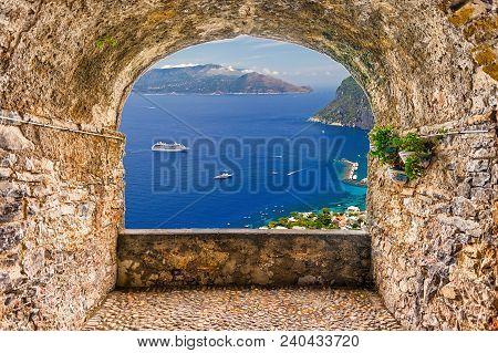 Scenic Rock Arch Balcony Overlooking The Beautiful Sorrento Peninsula From Capri, Bay Of Naples, Ita