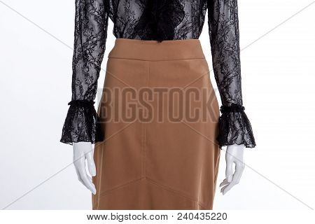 Close Up Brown Skirt And Lace Blouse. Female Mannequin With Cotton Skirt And Black Transparent Shirt