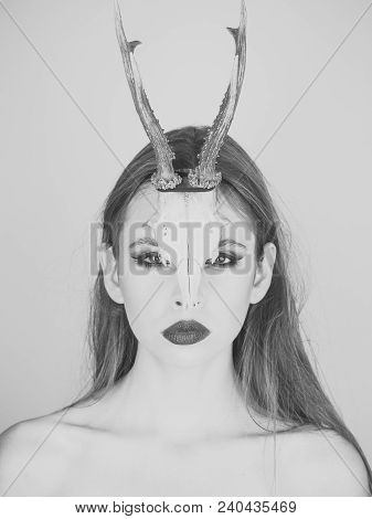 Fashion Devil Of Mystic Shaman Girl With Horns. Woman With Makeup And Antlers. Beauty Look And Cosme