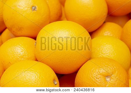 Vibrant Ripe Oranges In Peel. Tropical Fruit On Market. Sunny Yellow Citrus Fruit For Juice Or Cooki