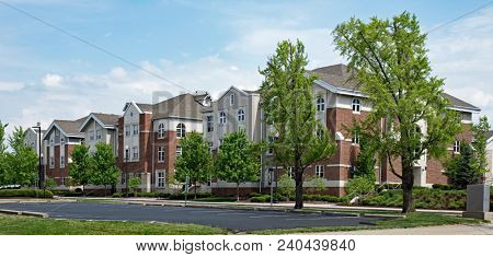 Upscale Red Brick & Tan Apartment Buildings