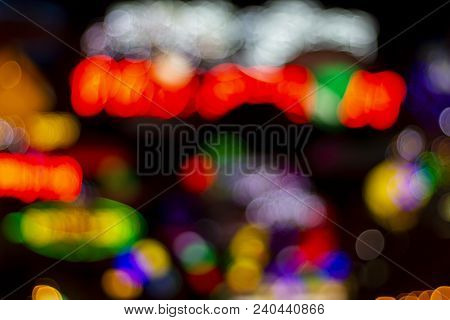 Blurry Nightlife Light On Dark Background. Outdoor City Night Life Blurred View. Glowing Illuminatio