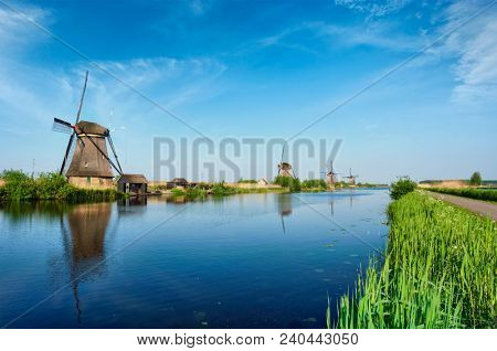 Netherlands rural lanscape with windmills at famous tourist site Kinderdijk in Holland