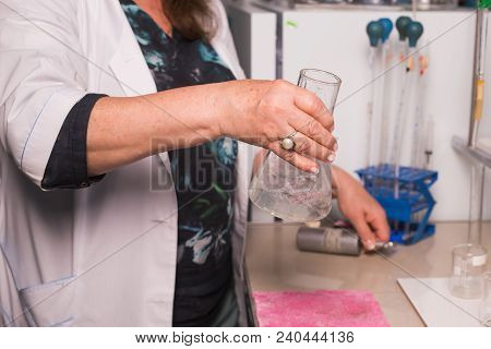 Chemist Works In A Lab. Lab Assistant Testing Water Quality Close Up
