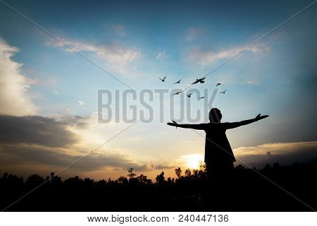 Silhouette People Showing Hand With Freedom And Success In Sun Shine