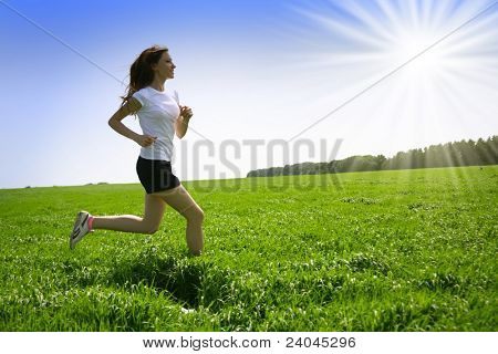 beautiful girl runs on grass