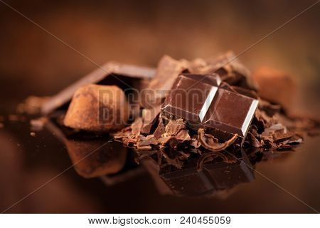 Assorted Chocolate Candies. Chocolate Sweets. Candy Design over dark Background. Various Chocolates. Confectionery