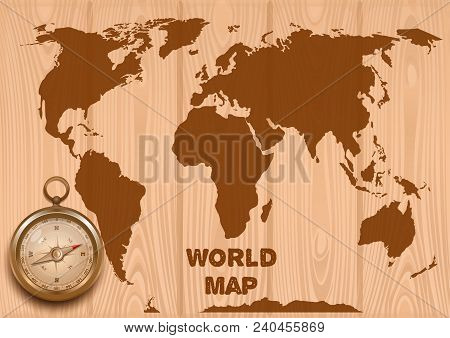 World Map And Golden Compass On A Wooden Background. Trip Around The World. Antique Retro Style Meta